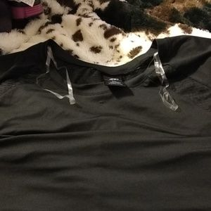 NWOT work out or swim shirt. Has mesh or netting